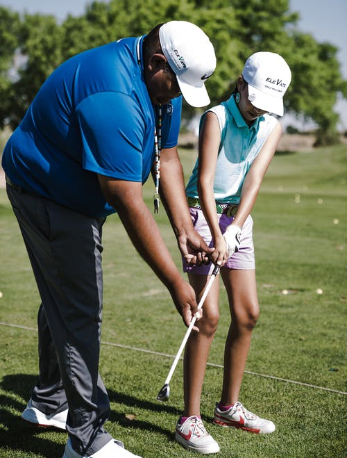 Girl Getting Golf Lessons